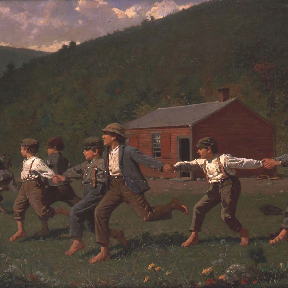 boys in field playing game snap the whip