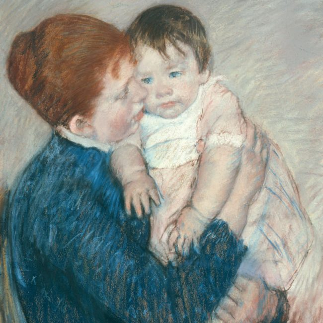 mother holding young child