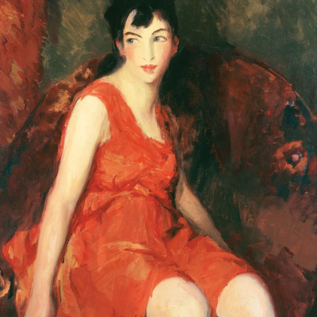 woman sitting wearing a red dress