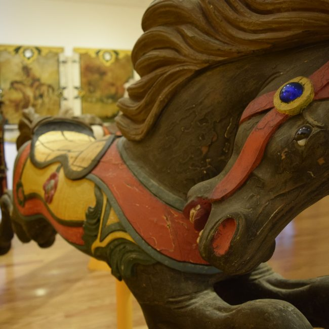 detail of brown carousel horse