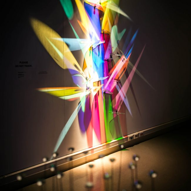 color triangles made with lights on the wall