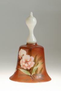 glass bell with flower painted on it