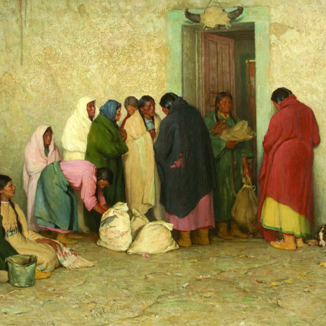 group of american Indians waiting in line for food