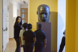 kids in front of African American bust